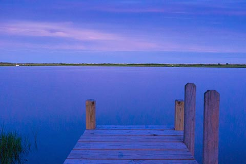sunset dock and water view